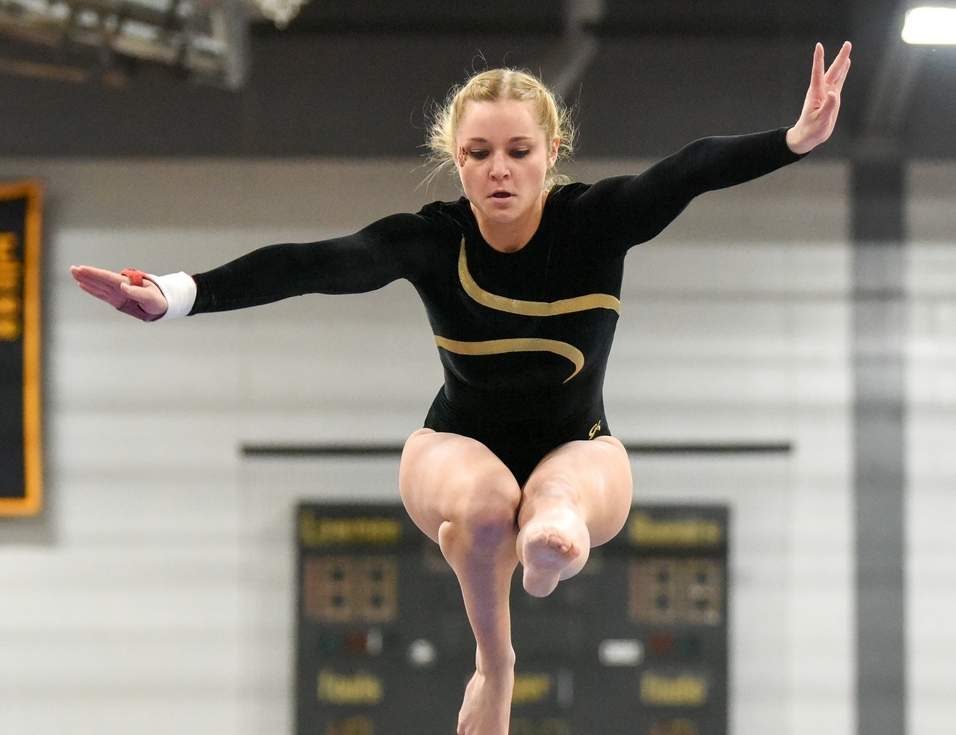 Senior tri-captain Olivia Finke was one of several key leaders who helped the Hand gymnastics squad stay on top of the SCC and state ranks once again in the recent season. Photo by Wesley Bunnell/The Source