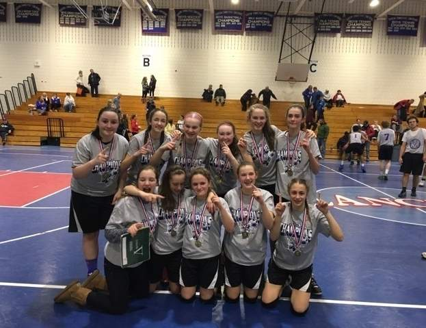 The Valley 8th-grade girls' basketball team stands proud after beating Mystic to win the tournament at the 38th annual Neil Hoelck event in Waterford. Photo courtesy of Rick Ross