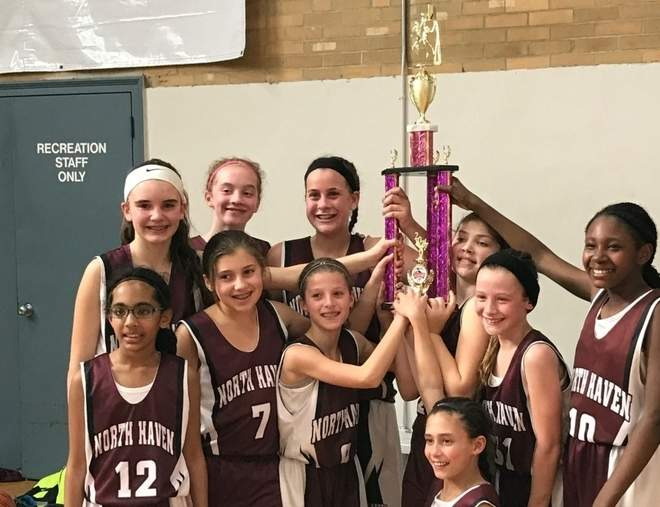The North Haven 5th-grade girls' travel basketball squad celebrates a 33-30 over Exeter-West Greenwich, Rhode Island to take the title at the Connecticut Hoopfest in Milford. Pictured are (back row) Grayce Christoforo, Ava Halovatch, Erika Fronte, Alyssa Collins, Ava Papa, and Damaria Williams; (front row) Alyssa Cherian, Ayva Caruso, and Cameron Ryan; plus (kneeling) Taylor O'Connor. Missing from the photo is Kylee McLain.  Photo courtesy of Sam Cherian