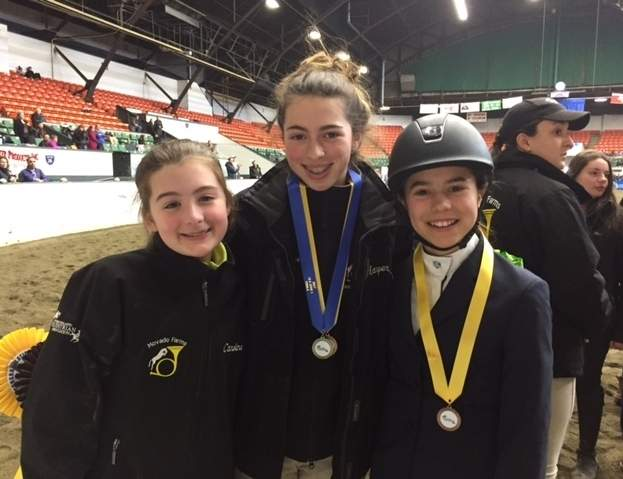Caroline Haskins (Essex), Harper Sanford (Chester), and Hanna Dolan (Essex) will compete on behalf of the Movado Farms Interscholastic Equestrian Association Middle School team at the Equestrian Nationals in Lexington, Virginia. Photo courtesy Megan Haskins