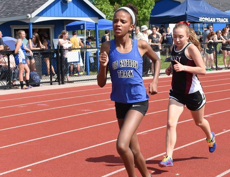Jael Givehand won the 1,600 and also ran on the triumphant 4x800 relay when the Old Saybrook girls' outdoor track team took first place at the Bellringer Invitational on April 8. Photo by Kelley Fryer/Harbor News