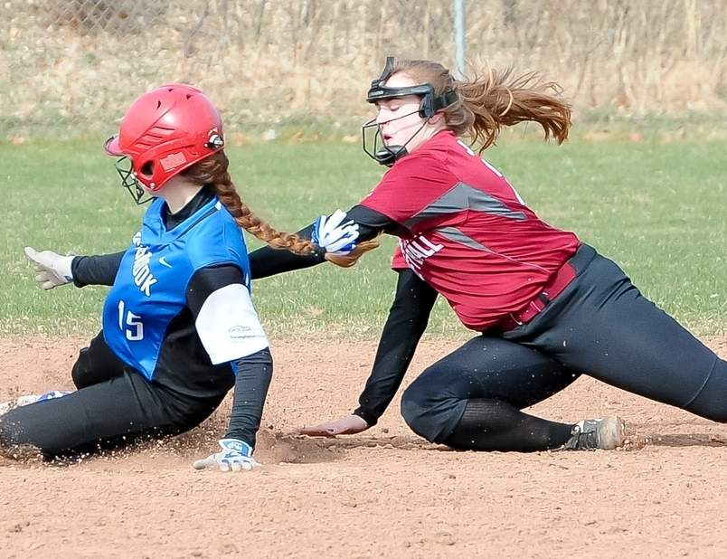 Old Saybrook's Megan Schulmeister (left) slides in safely while Valley Regional's Julia Jenkins applies the tag during a game between the Shoreline Conference rivals on April 7. Valley came away with a 19-4 victory at Old Saybrook High School on April 7. Photo by Kelley Fryer/The Courier