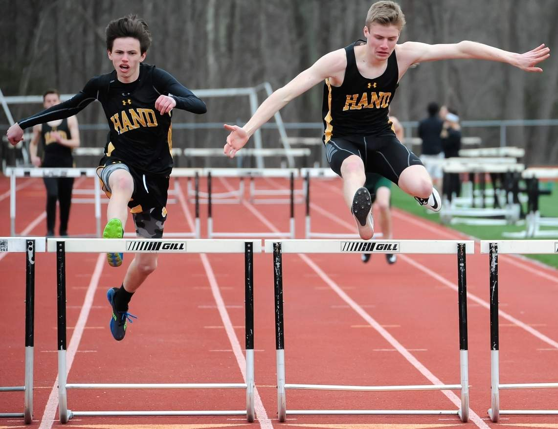 Victorious performances from Greyson McGeary and Matt Parker in the hurdling events propelled the Hand boys' outdoor track to a 93-57 win over Guilford in its season opener on April 5. Photo by Kelley Fryer/The Source