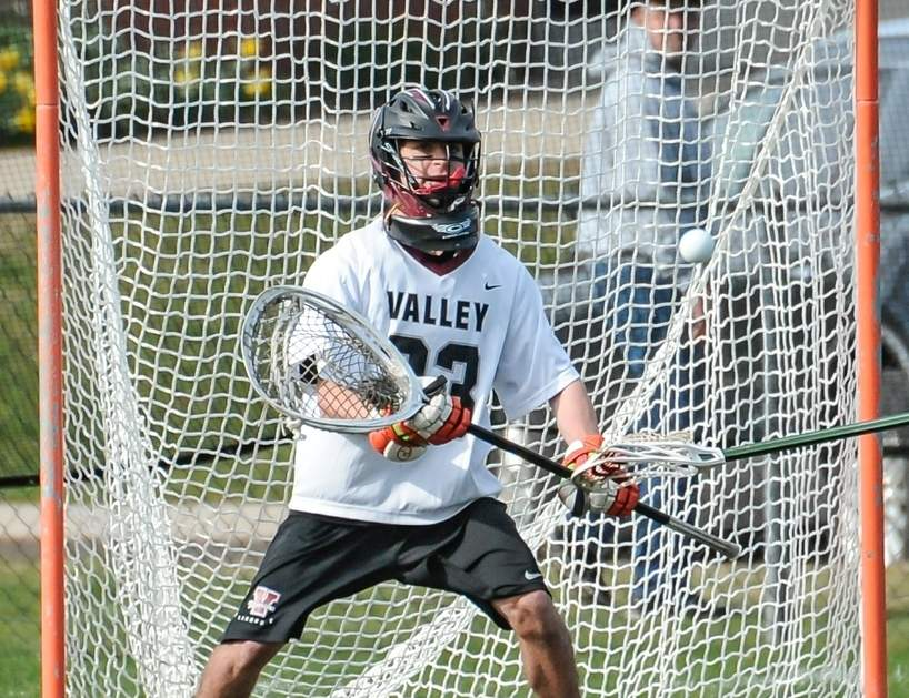 Senior captain Jacob Azzinaro made 31 saves between the Valley Regional boys' lacrosse team's two recent games. The Warriors beat Cromwell 22-4 and then defeated Old Lyme 17-11 to improved to 3-0 for the season. Photo by Kelley Fryer/The Courier