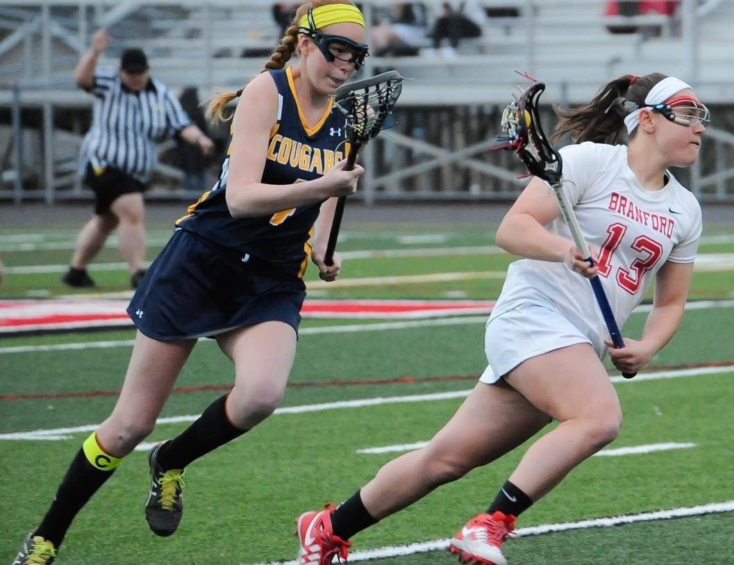 Sabrina Torcellini found the back of the net eight times when the Branford girls' lacrosse team beat Haddam-Killingworth for its first victory of the season on April 13. Photo by Kelley Fryer/The Sound