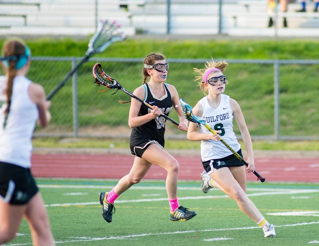Rhiannon Zergiebel and the Guilford girls' lacrosse team picked up its first win of the year by notching a 14-9 victory against Sheehan on April 10. Photo by Chris Eadevito/The Courier