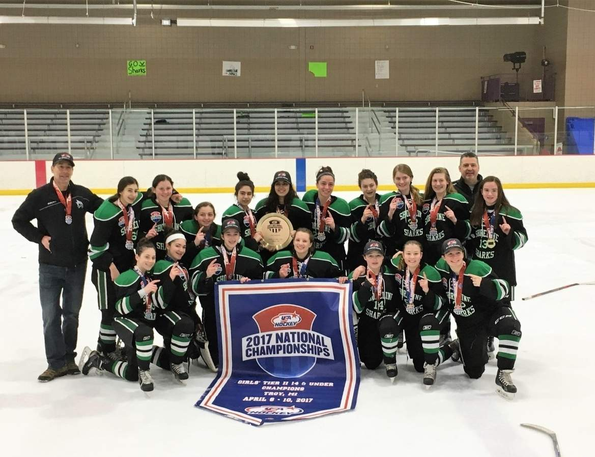 The Shoreline Sharks U-14 Black girls' ice hockey squad took the USA Hockey 2017 Tier II national title by posting a 2-0 win over the Wisconsin Black Cats in Troy, Michigan on April 10. Pictured from the Sharks are (front row) Claire Gavin (Durham), Meagan Spring (North Haven), Carina Mancini (Middlefield), Jenna Guglielmi (Branford), Lauren Mullally (New Haven), Katie Porrello (Milford), and Lucy Schumann (Stratford); (back row) Coach Joe Buccheri (Cromwell), Daniella Buccheri (Cromwell), McAllister Dixon (Woodbridge), Sophia Rodham (Madison), Melissa Montesi (North Haven), Juliana Constantinople (East Haven), Taylor Nowak (West Haven), Cecile Tobin (North Haven), Megan Froehlich (West Haven), Kate Hagness (Guilford), Coach Ed Rodham (Madison), and Abby Hart (Fairfield). Photo courtesy of the Shoreline Sharks