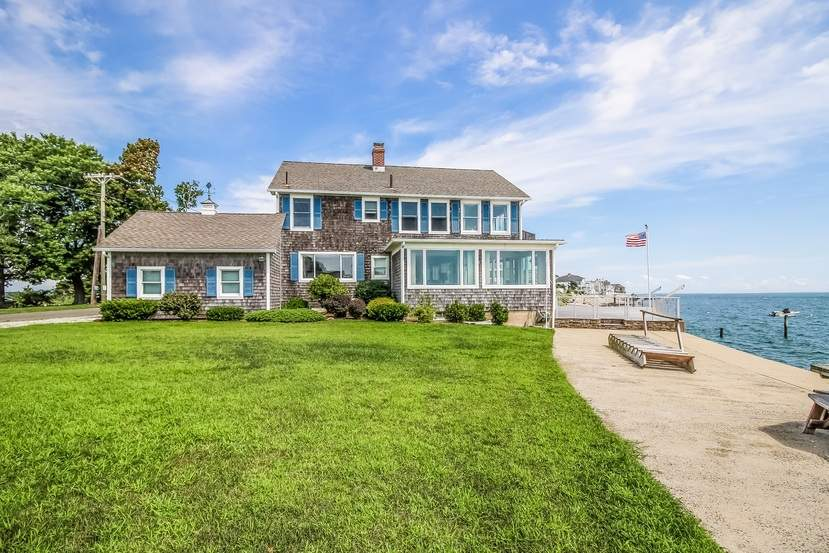 Beach, deck, lawn, and Long Island Sound come together in this waterfront Clinton home.
