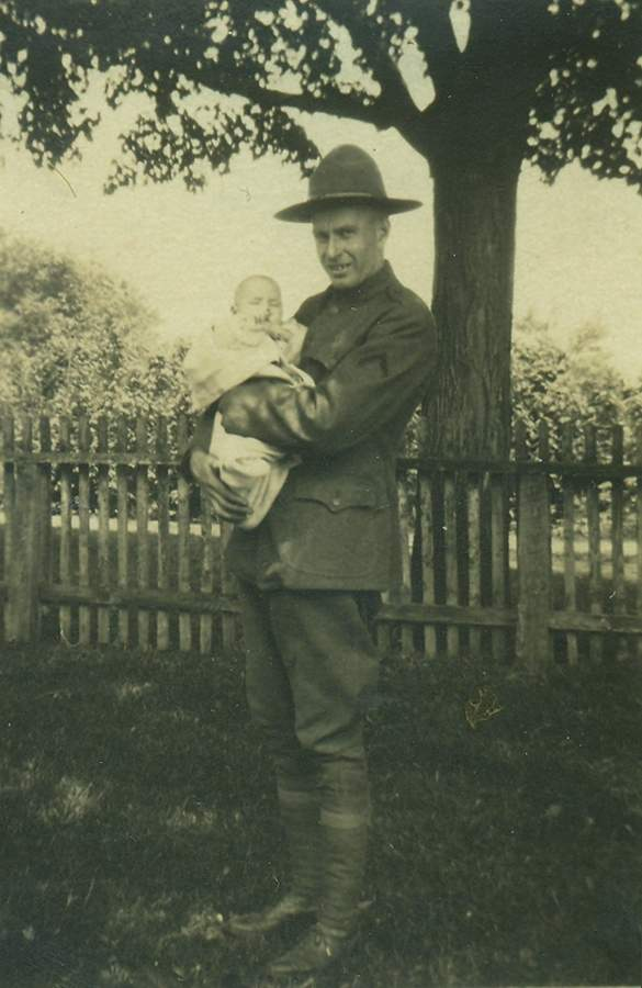 Elville L. Harris, a World War I veteran, moved from Killingworth to Madison after the war and worked as a mechanic. Harris is holding his son Leroy Harris on Memorial Day 1925, Leroy Harris would go on to serve in World War II.   Photo courtesy of the Charlotte L. Evarts Memorial Archives