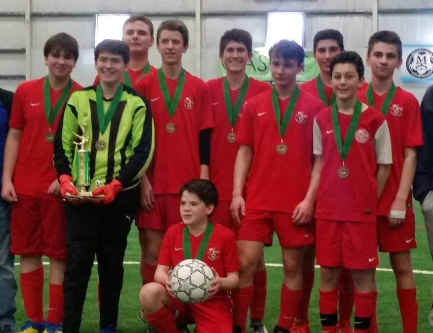 The Valley Soccer Club's 8th-grade U-14 boys' indoor soccer team recently defeated Norwich to win the Southeast Connecticut Junior Soccer Association Indoor Soccer championship. Pictured are assistant coach Rob Ingham, Tate Ingham, Jackson Bisson, Adam Carroll, Cameron Ruel, Michael Brooks, Alex Pinkowish, Ryan Shea, Andrew Sherman, Sam Helsel, and Head Coach Greg Ruel, along with (kneeling) Aidan Fleming. Photo courtesy of Mary Boone