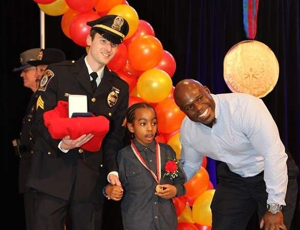 Amari Denzel Timmons was one of two Guilford residents who was presented with the Spirit of Life Award from Special Olympics Connecticut at its annual Hall of Fame event. Timmons is pictured with police officer Kory Vincent (left) and Apollo Crews (right) from World Wrestling Entertainment. Photo of Special Olympics Connecticut