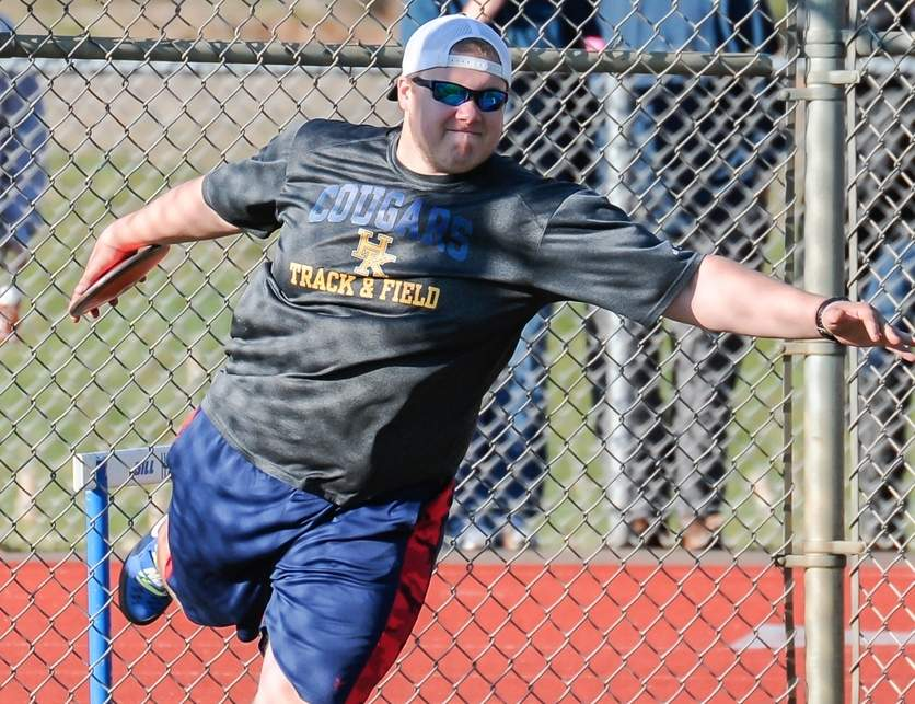 Nate Breiling took first place in the discus to help the Haddam-Killingworth boys' outdoor track team earn a split of a home tri-meet on April 18. The Cougars defeated Creed and took a loss against Old Saybrook. Photo by Kelley Fryer/The Source