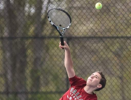 Junior Jeffrey Riggio is 3-1 on the season playing the No. 1 singles position for Head Coach Bunny Logan and the Warriors' boys' tennis team this spring. Photo by Kelley Fryer/The Courier