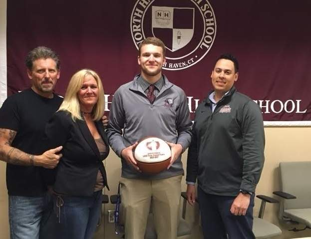 On April 27, Jack Steinman was honored for scoring career point No. 1,000 as a member of the Indians' boys' basketball squad during the recent winter season. Pictured are Steinman's parents, John and Linda, with Steinman and Head Coach Justin Falcon. Photo courtesy of Steve Blumenthal