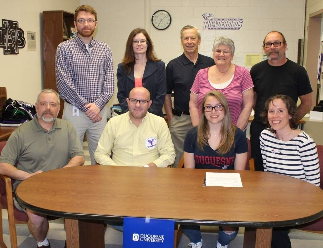 North Branford High School senior Peyton Joiner will continue her diving career at Division I Duquesne University in Pittsburgh this fall. Pictured are (front row) Joiner's dad Randy Joiner, Branford girls' swimming and diving Head Coach Scott Butler, Joiner, and her mother Ashley Joiner; along with (back row) North Branford's Ultimate Frisbee Head Coach Jacob Sweet, Joiner's stepmother April Lenox, her grandfather Sid Clow, grandmother Nancy Clow, and stepfather Tommy Hinman. Photo courtesy of Ashley Joiner