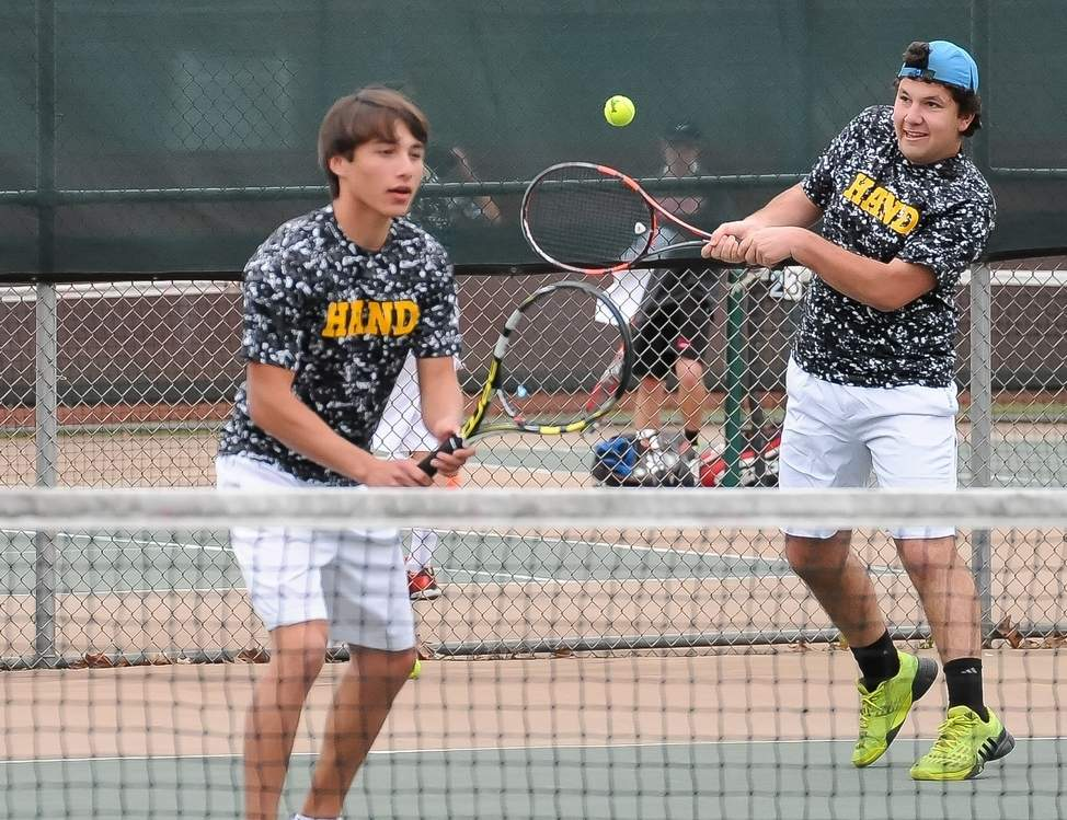 Juniors Rob Israel (left) and Alex Bueno are part of a deep Hand boys' tennis team that is setting its sights on an undefeated regular season, as well as the SCC Division I and Class L state crowns this spring. Photo by Kelley Fryer/The Source
