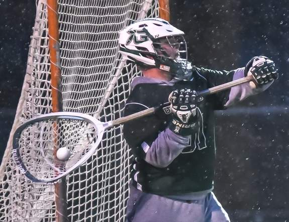 Senior co-captain Evan Hilgert has been solid in net to help the Guilford boys' lacrosse team get out to a steady start and begin the push toward its peak in the second half of the season. Photo by Kelley Fryer/The Courier