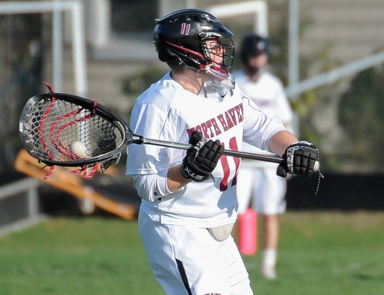 Goalkeeper Dustin Byrnes and the North Haven boys' lacrosse squad have won their last six games and own a record of 10-1 after blowing out East Lyme and edging out Notre Dame-West Haven in last week's action. Photo by Kelley Fryer/The Courier