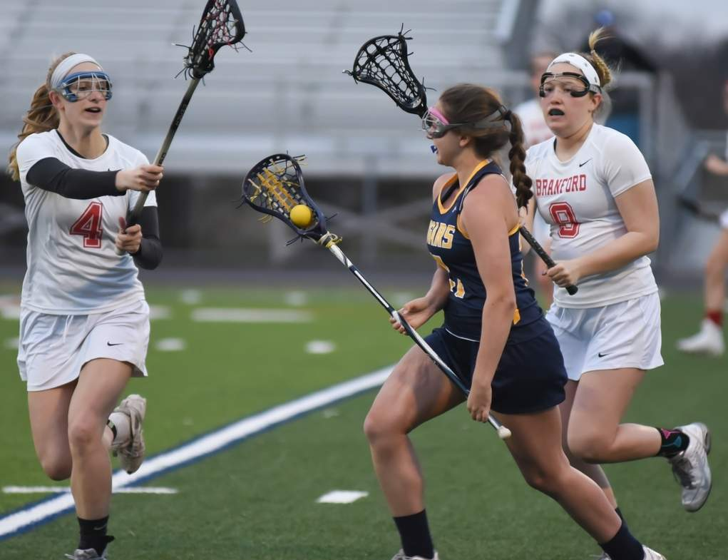 Sophie Spencer (left), Erin O'Brien (right), and the Branford girls' lacrosse squad improved to 9-2 after posting three victories in last week's action, while sealing a spot in the Class M State Tournament in the process. Photo by Kelley Fryer/The Sound