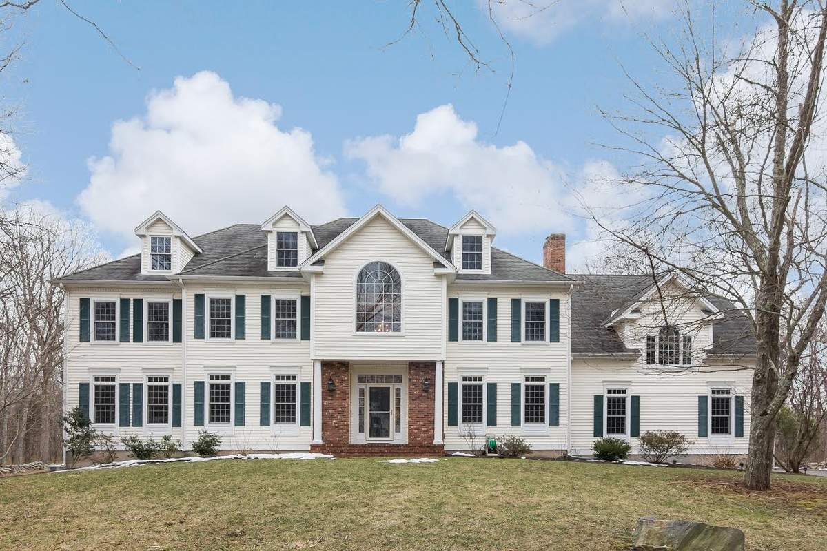 Four full levels of living space ensure room for any pursuit at this spectacular home in Guilford.