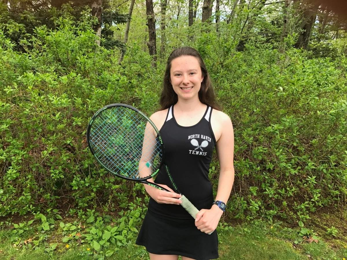 Senior captain Olivia Hoyt sports a record of 11-2 playing No. 2 singles for the North Haven girls' tennis team. Olivia has also received a SCC Scholar Athlete Award as a captain of the Indians' girls' cross country squad and placed ninth at the Individual State Championship for the fencing team this winter. Photo courtesy of Olivia Hoyt