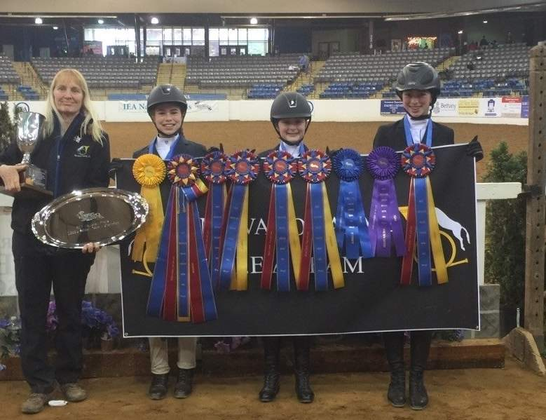 Essex residents Hanna Dolan and Caroline Haskins teamed up with Chester's Harper Sanford to take the national title at the Equestrian Nationals in Lexington, Virginia, while representing the Movado Farms Interscholastic Equestrian Association Middle School team. Photo courtesy of Sasha Sanford
