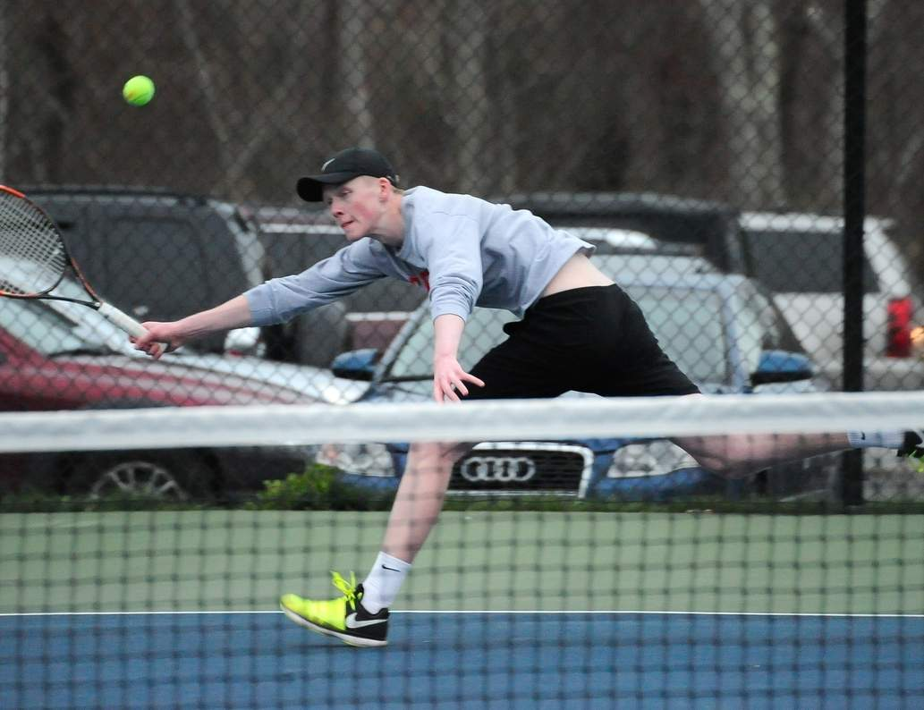 Senior Gus Marx and the Westbrook boys' tennis team continue to topple the opposition this spring. The Knights are inching closer to an undefeated season with their record of 16-0. Photo by Kelley Fryer/Harbor News