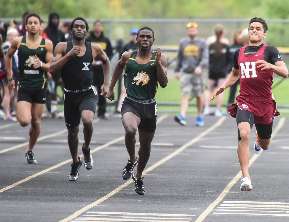 Omar Gebril (right) claimed first place in three events when the North Haven boys' outdoor track team beat Career to clinch the Oronoque Division title. Photo by Kelley Fryer/The Courier