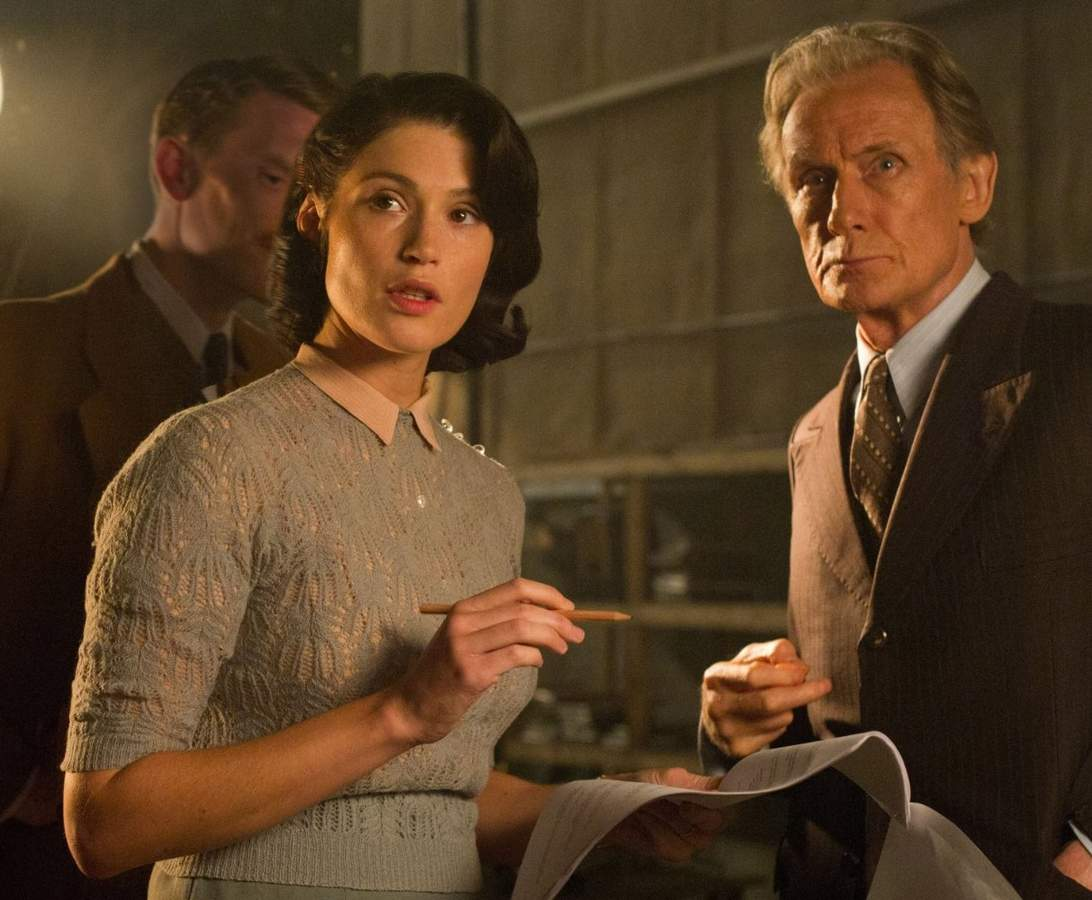 Catlin Cole (Gemma Arterton) and Ambrose Hilliard (Bill Nighy) talk over the script for their film in Their Finest. Photograph and copyright by Nicola Dove. BBC Films