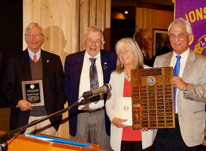From left are Madison Lions Club 2017 Public Service Award winner Michael Piccione, Madison Lions Club President Louis Tresselt, Madison Chamber of Commerce Executive Director Eileen Banisch, and Madison First Selectman Thomas Banisch. Piccione is holding the plaque presented to him by the Lions. The Banisches are holding the plaque with names of all recipients of the award since inception. This plaque is on display at Town Hall. Photo by George Basler