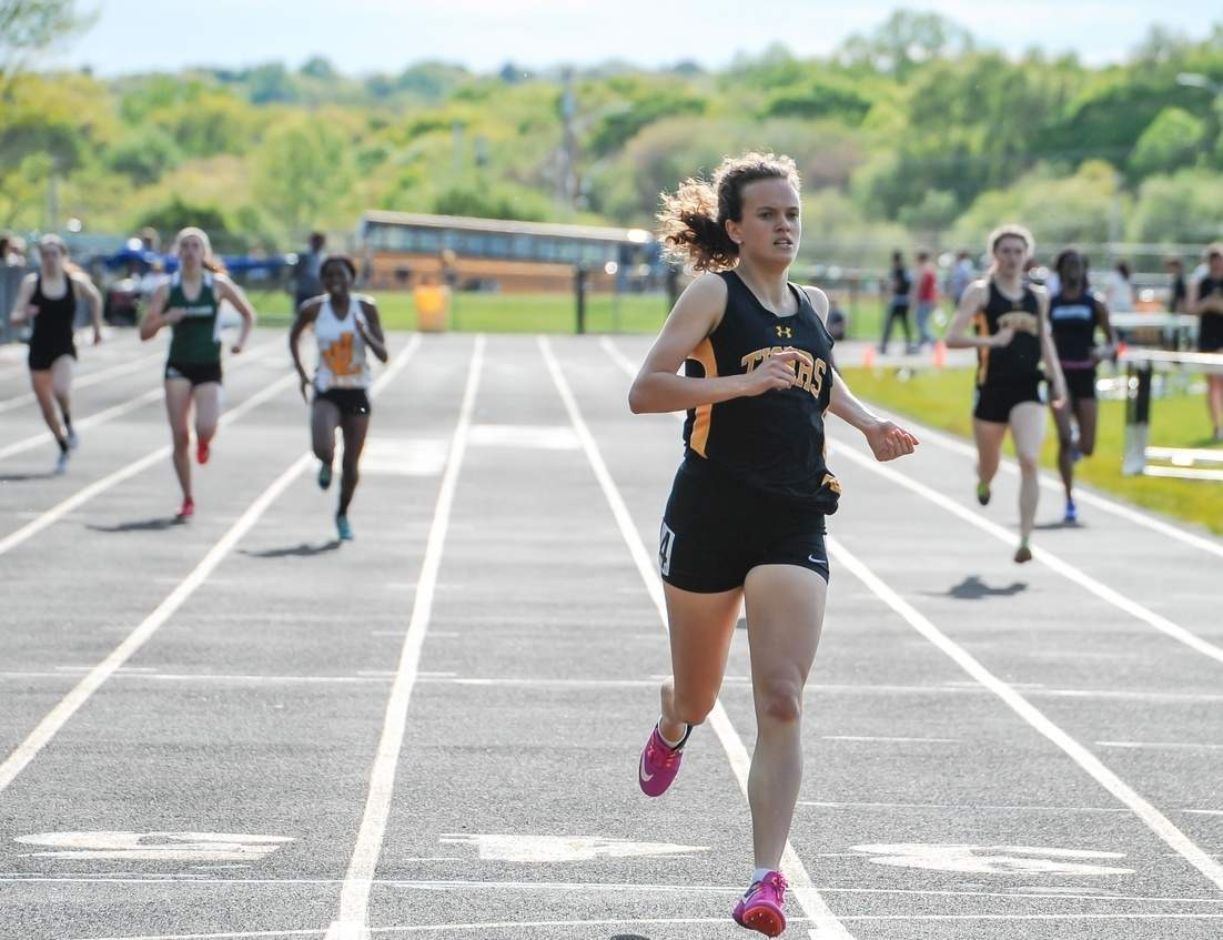 Caroline O'Neil took first place in the 100, 200, and the 400 for the Hand girls' outdoor track squad at last week's SCC East Sectional Championship. Photo by Kelley Fryer/The Source
