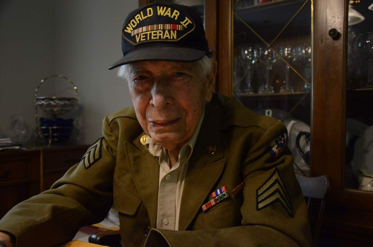 At his Branford home, Bill Brody shares recollections of his days of military service during World War II and wears his Army uniform, complete with meritorious decorations and sergeant stripes. Bill will lead the 2017 Branford Memorial Day Parade as parade marshal on Monday, May 29. Photo by Bill O'Brien