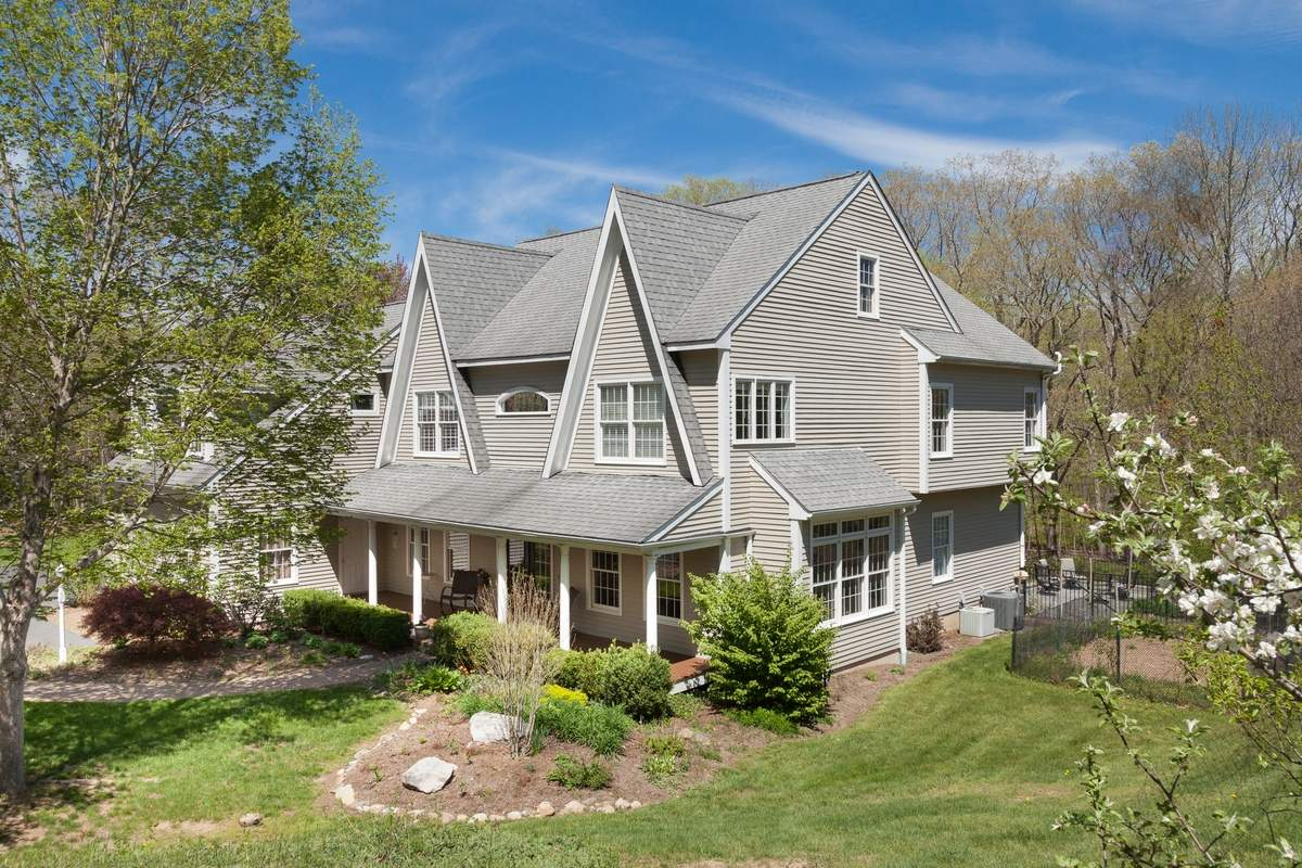 This contemporary Colonial home in Guilford sits on more than four acres of land.