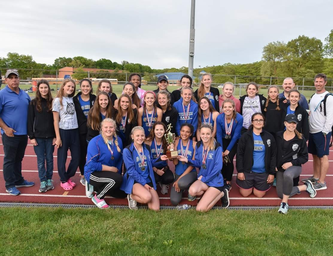 The Old Saybrook girls' track team celebrates after taking first place at the Shoreline Conference Championship for the second year in row. The Rams scored 182.75 points and breezed by runner-up Coginchaug, which totaled 115 points at Morgan High School on May 24. Photo by Kelley Fryer/Harbor News