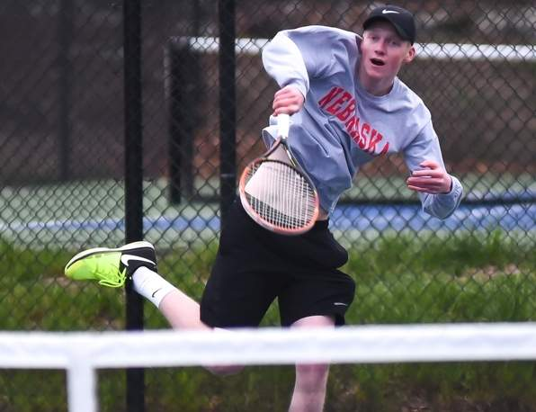 Senior captain Gus Marx won a three-set match at No. 1 singles to help the Knights' boys tennis team complete a perfect 20-0 regular season with a 7-0 sweep over Granby Memorial on May 23. Photo by Kelley Fryer/Harbor News