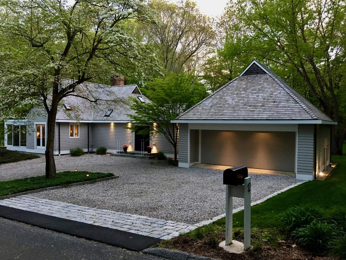 A breezeway links home and garage at this unique property.