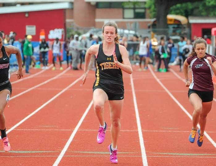 Caroline O'Neil won Class L state titles in the 100, 200, and 400 to help Hand girls' outdoor track finish third as a team at the state meet on May 30. Photo by Kelley Fryer/The Source