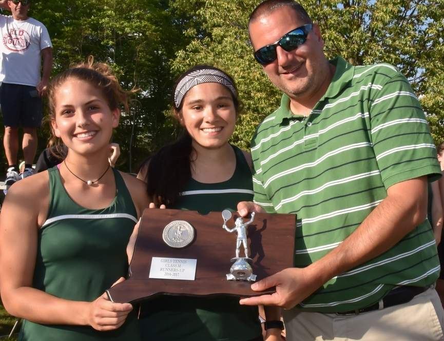 Captains Claire Dinauer and Samantha Stofflet hold up the runner-up trophy with Head Coach Chris Marra following the Guilford girls' tennis team's match against Hand in the Class M State Tournament final on June 1. The Indians took a 5-2 loss against Hand and finished the year with a record of 18-8. Photo by Kelley Fryer/The Courier
