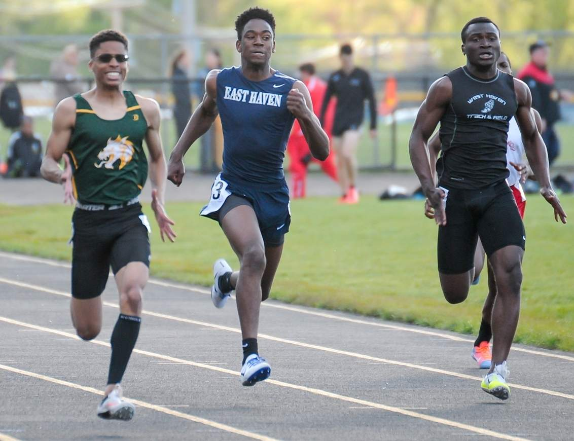 Jordan Ingram posted points in both the 100- and 200-meter dashes for East Haven at the Class MM Boys' Outdoor Track Championship on May 31. Photo by Kelley Fryer/The Courier