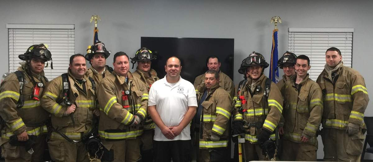 Bobby Santoro, surrounded by his colleagues at North Haven Fire Department Northeast Company 4, has found a second family in the company, for which he serves as captain. Photo by Matthew DaCorte/The Courier