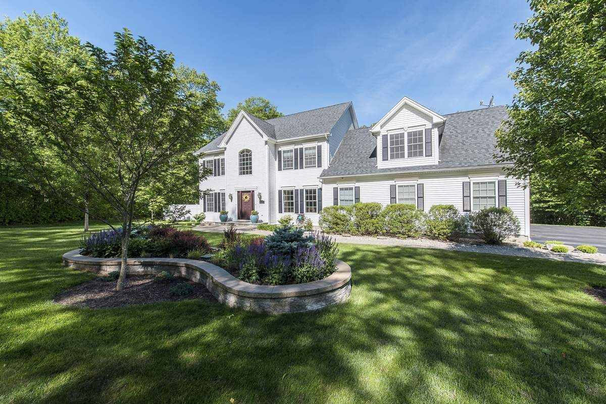 The professionally landscaped, 3.5-acre property includes a manicured lawn.