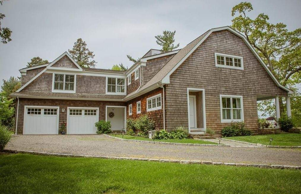 This lovely custom home overlooks the   Pine Orchard Golf Course in Branford.