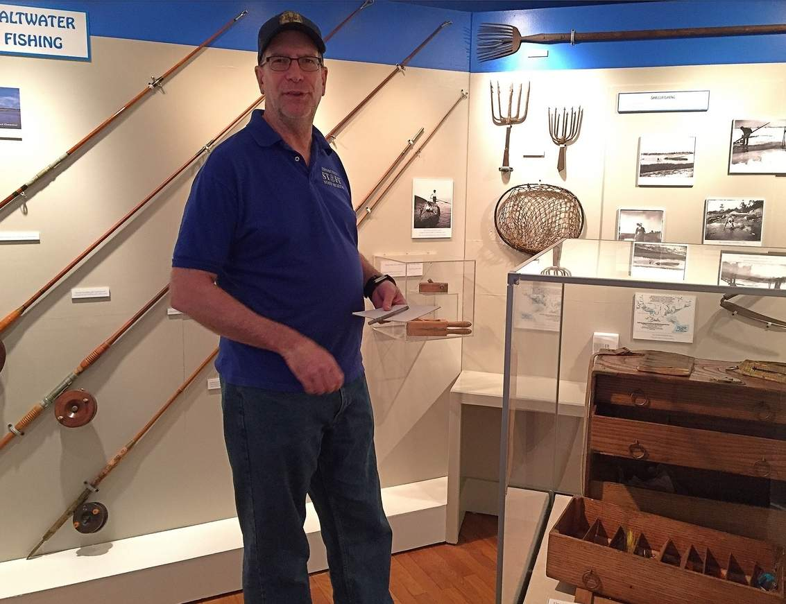 An array of fishing gear used throughout the centuries now on exhibit at the Henry Whitfield Museum in Guilford, with curator Michael McBride. Photo courtesy of Captain Morgan