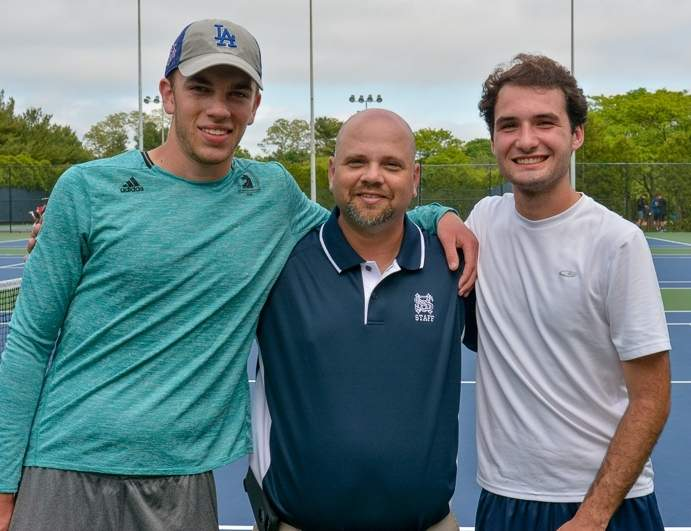 Senior Sam Moran and junior Matthew Newfield advanced the furthest of any doubles team in Morgan boys' tennis history by reaching the semifinals of the recent Class S State Championship at the Yale Tennis Center. Pictured are Moran, Huskies' Head Coach Christopher Zawadski, and Newfield. Photo courtesy of Carolyn Newfield