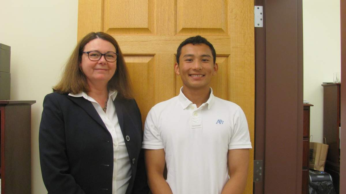 In a few short months as an intern, Tenzin Rabjam (right), then an Old Saybrook High School senior (he graduated on June 15), proved himself so valuable to Town Finance Director Lee Ann Palladino (left) and First Selectman Carl Fortuna, Jr., that the town hired him part time to help convert to a new accounting and payroll system. He'll take his government experience with him this fall to American University in Washington, D.C., where he'll focus his studies on politics. Photo by Becky Coffey/Harbor News