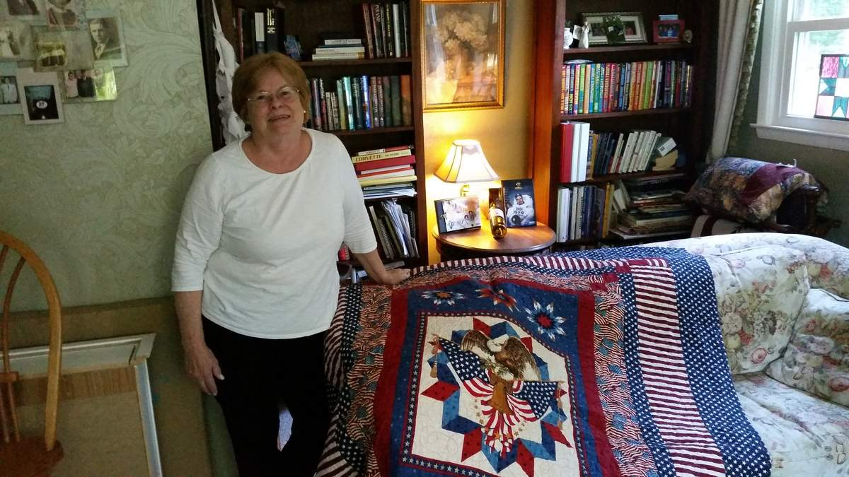 With hours of handiwork and sometimes a hug upon delivery, Nancy Burns shows local veterans that their service is appreciated. Nancy helps run the Old Saybrook Piecemakers, a local branch of the Quilts of Valor Foundation, and in addition to seeking nominees to be honored with a quilt, she's hoping to find a few good stitchers (training is available). Photo by Eric O'Connell/Harbor News