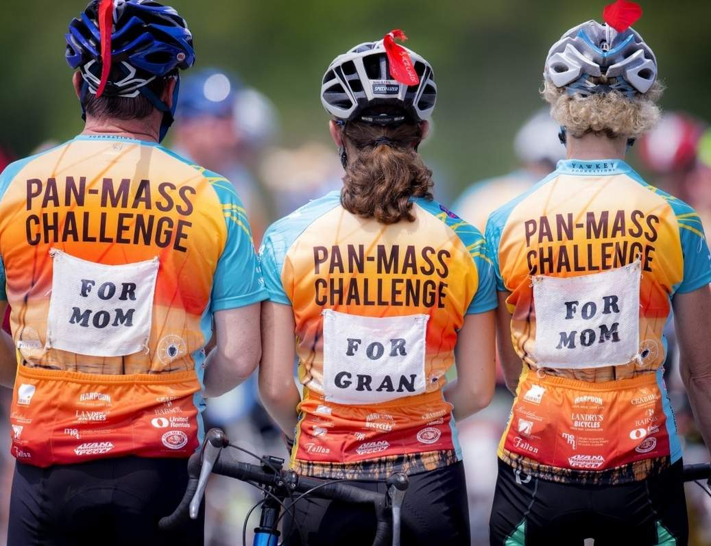 Seven local cyclists will raise money for cancer research at the Dana-Farber Cancer Institute by participating in the Pan-Mass Challenge on Saturday, Aug. 5 and Sunday, Aug. 6. Pictured are three past participants from the event. Photo courtesy of Hannah Charney