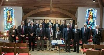 Members of the Cappella Cantorum Men's Chorus, front row, from left to right: Norm Andrea, Dean Cloutier, Bob Stosse, Rolf Perterson, Barry Asch , Deborah Lyon, Len Dongweck, Tony Carrano, John Van Epps, and Bob Johnson. Back row, left to right, Dud Bickford, Michael Minkos, Tor Hepburn, Alan Macgregor, Larry Morse, Fred Johnson, John Newman, Missing, Tom Speer, and Ed Bosse. Photo courtesy of Cappella Cantorum Men's Chorus