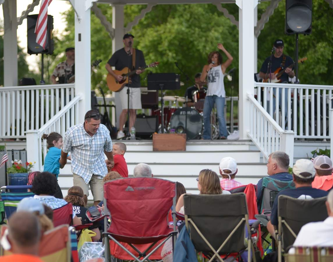 The Clinton Chamber of Commerce started off the 20th annual Guilford Savings Bank Summer Concert Series on Thursday, July 6 at 6:30p.m.  with the Rock Bottom Band performing at the Vece Gazebo at the Pierson School. Jerry Warner  dances with Lila  and Lincoln Baird.