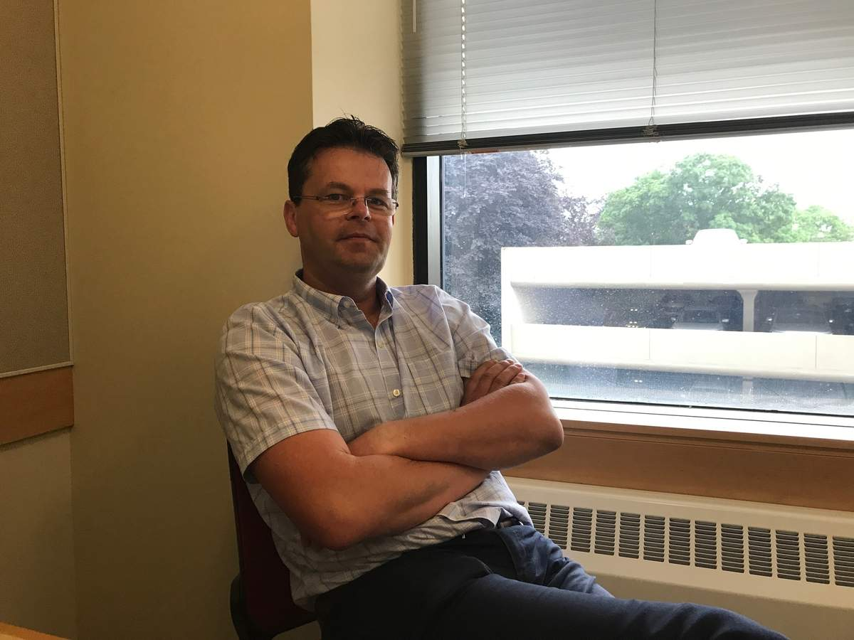 After a full workweek at Yale, Madison's Attila Tobias prepares for his other calling as paster and Sunday Hungarian School teacher at the Evangelical and Reformed United Church of Christ in Wallingford. Photo courtesy of Attila Tobias